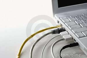cords-plugged-laptop-computer-12976791